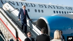 FILE - U.S. Secretary of State John Kerry arrives at Queen Alia Airport in Amman, Jordan, Sept. 10, 2014.