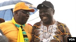FILE: Former Prime Minister Morgan Tsvangirai shares a joke with his former finance minister, Tendai Biti, at a rally of about 500 people in Harare, March 22, 2017.