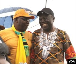 Former Prime Minister Morgan Tsvangirai shares a joke with his former finance minister, Tendai Biti, at a rally of about 500 people in Harare, March 22, 2017. Tsvangirai said the next election is heading for a dispute.