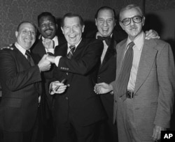 FILE - Comedian Henny Youngman, second from right, clowns with celebrities, left to right, Don Rickles, Sugar Ray, Milton Berle and Jack Albertson in the Beverly Hills, California Hilton, Nov. 17, 1978.