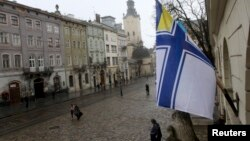 A Ukrainian Naval Forces flag is on display at the city hall building in Lviv, in support of Ukrainian military sailors based in Crimea, March 6, 2014.