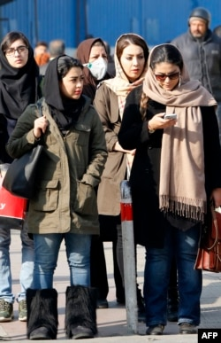 Iranian women wearing hijab walk down a street in the capital Tehran, Feb. 7, 2018. A spate of protests against Iran's mandatory headscarves for women have been few but have reignited a debate that has preoccupied the Islamic republic since its founding.