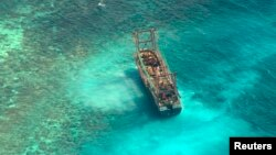 A Chinese fishing vessel that ran aground in Tubbataha Reef, a UNESCO World Heritage site, on Monday is pictured in Palawan Province, west of Manila, April 10, 2013.