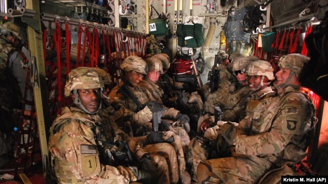U.S. Army soldiers from the 3rd Brigade Combat Team, 101st Airborne Division sit on a plane at Forward Operating Base Salerno in Afghanistan to return home to Fort Campbell, Ky., May 21, 2013