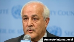 FILE - Palestinian Ambassador Riyad Mansour speaks at U.N. headquarters, July 28, 2014. Mansour on Wednesday accused Israel of continuing to break international law as it builds settlements in occupied territory.