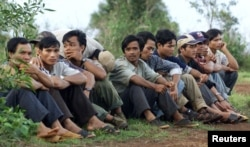 FILE PHOTO - Montagnards who recently fled Vietnam's Central Highlands wait in Senmonorom in Mondolkiri province which borders Vietnam, May 15, 2001.