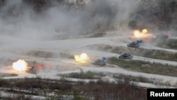 FILE - South Korean Army K1A1 and U.S. Army M1A2 tanks fire live rounds during a U.S.-South Korea joint live-fire military exercise near the demilitarized zone separating the two Koreas in Pocheon, South Korea, April 21, 2017.