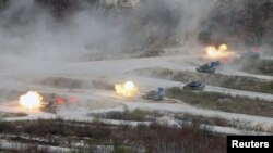 FILE - South Korean Army K1A1 and U.S. Army M1A2 tanks fire live rounds during a U.S.-South Korea joint live-fire military exercise, at a training field, near the demilitarized zone, separating the two Koreas in Pocheon, South Korea April 21, 2017.