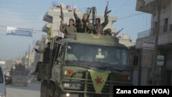 Şervanên YPG rizgarkirina Til Hemîs pîroz dikin