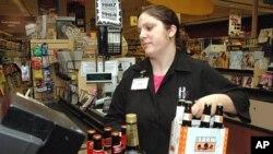A cashier at Holiday Market, in Royal Oak, Michigan, rings up alcohol purchases, May 3, 2005.
