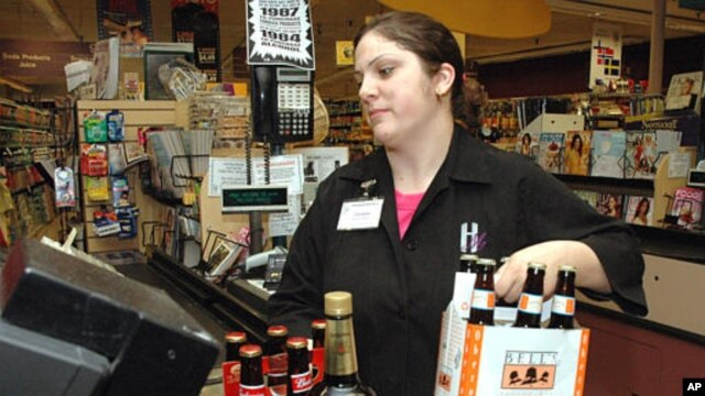 A cashier at Holiday Market, in Royal Oak, Michigan, rings up alcohol purchases, May 3, 2005.