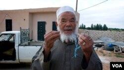 Mohamed talks about farming under the Gadhafi regime, April 9, 2012. (Stephanie Figgins)