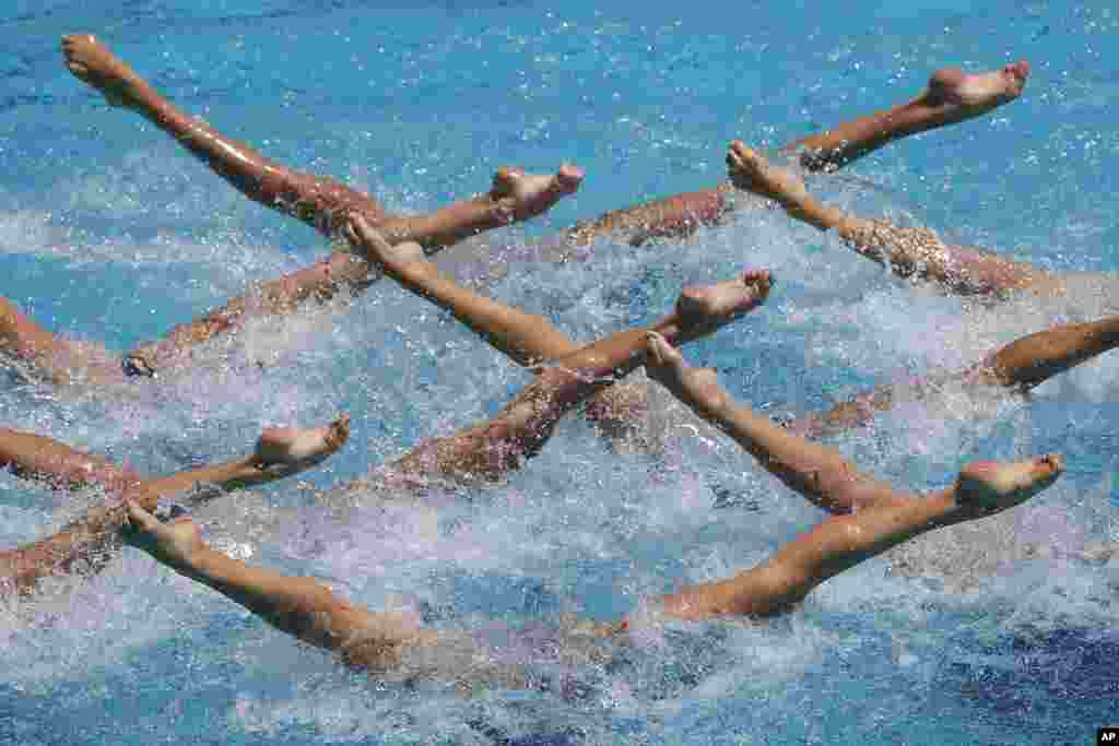 A Ukrainian team performs their Free Routine during the Synchronized Swimming Olympic Games Qualification Tournament at the Maria Lenk Aquatics Center in Rio de Janeiro, Brazil.