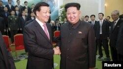 朝鲜领导人金正恩会见中共政治局常委刘云山率领的中共访朝代表团 (2015年10月)