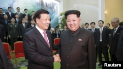 FILE - North Korean leader Kim Jong Un receives a delegation of the Communist Party of China led by Liu Yunshan in October 2015. Washington and its Asian allies are strongly committed to taking a tough sanctions-based approach to pressure North Korea to give up its nuclear weapons, but questions remain about Beijing's level of commitment.