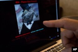 FILE - A computer screen shows Malaysia Airlines' hacked website on Jan. 26, 2015.