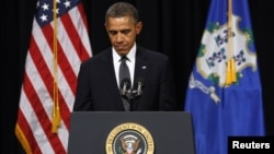 U.S. President Barack Obama speaks at a vigil held at Newtown High School for families of victims of the Sandy Hook Elementary School shooting in Newtown, Connecticut December 16, 2012.