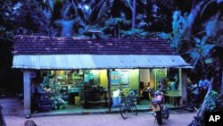 Sir Lankan village shop at dusk lit by solar panels - Nanotechnology could help make solar cells more accessible, efficient and affordable