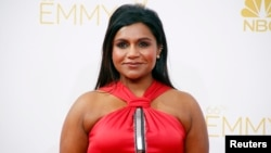 FILE - Mindy Kaling arrives at the 66th Primetime Emmy Awards in Los Angeles, California, Aug. 25, 2014.