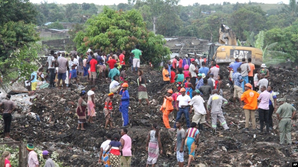 Image result for Huge heap of refuse dump collapses in Mozambique killing 17 people and crushing several homes