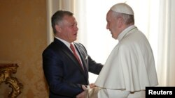 Pope Francis greets Jordan's King Abdullah during a private meeting at the Vatican Dec. 19, 2017.