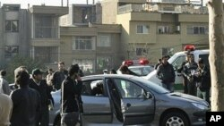 This photo released by the Fars News Agency is said to show one of the damaged cars following bomb attacks on the vehicles of two nuclear scientists in Tehran, Iran, 29 Nov 2010
