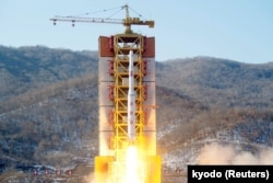 FILE - A North Korean long-range rocket is launched into the air at the Sohae rocket launch site, North Korea, in this photo released by Kyodo, Feb. 7, 2016.