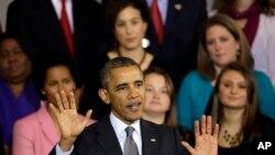 奥巴马总统2013年10月30日在美国东部城市波士顿举行的市镇会议上发表有关医保法的事宜。