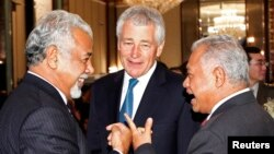 East Timor PM Xanana Gusmao (L-R) mingles with Indonesia's Defence Minister Purnomo Yusgiantoro and U.S. Defense Secretary Chuck Hagel before the keynote address of the 12th International Institute for Strategic Studies (IISS) Asia Security Summit: The Sh