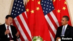 China's President Xi Jinping speaks during his meeting with U.S. President Barack Obama (R), on the sidelines of a nuclear security summit in The Netherlands on March 24 2014.