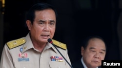 Thailand's Prime Minister Prayuth Chan-ocha speaks during a news conference after his meeting with National Security Council as Deputy Prime Minister and Defense Minister Prawit Wongsuwan looks on at Government House in Bangkok, Aug. 15, 2016.