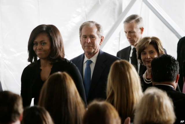 First lady Michelle Obama, from left, former President George W. Bush and Laura Bush leave the funeral service for former first lady Nancy Reagan at the Ronald Reagan Presidential Library in Simi Valley, California, March 11, 2016.