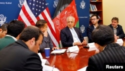 FILE - U.S. special envoy for peace in Afghanistan, Zalmay Khalilzad, center, speaks during a discussion with Afghan media at the U.S Embassy in Kabul, Afghanistan Jan. 28, 2019.