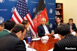 FILE - U.S. special envoy for peace in Afghanistan, Zalmay Khalilzad, center, speaks during a roundtable discussion with Afghan media at the U.S Embassy in Kabul, Afghanistan Jan. 28, 2019.