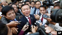 Cambodia's main opposition Cambodia National Rescue Party Acting President Kem Sokha, center, speaks to reporters outside the Phnom Penh Municipality Court in Phnom Penh, Cambodia, Wednesday, April 8, 2015.