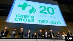 Participants applaud on September 2, 2013, in Geneva during the opening of a conference to celebrate the 20th anniversary of Green Cross International.