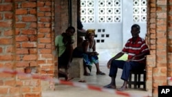 People suspected of having the Ebola virus wait at a treatment center in Bikoro, Democratic Republic of Congo, May 13, 2018. Congo's latest Ebola outbreak has spread to a city of more than 1 million people, a worrying shift.