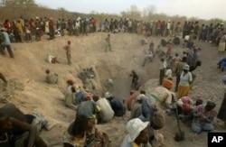Local miners prospecting for diamonds in Zimbabwe's Marange fields.