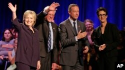Democratic presidential candidates, from left, Hillary Clinton, Sen. Bernie Sanders and former Maryland Governor Martin O'Malley participate in a candidate forum hosted by MSNBC's Rachel Maddow, right, at Winthrop University in Rock Hill, S.C., Nov. 6, 20