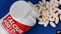 This photo shows a container of over the counter calcium supplements. A recent study found that most supplements do not help heart health and calcium with vitamin D may even harm it.