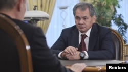 Newly-appointed Defense Minister Sergei Shoigu meets with Russian President Vladimir Putin at the Novo-Ogaryovo state residence outside Moscow, November 6, 2012.