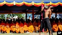 """Cambodian students re-enact torture executed by the Khmer Rouge to mark the annual """"Day of Anger"""" at Choeung Ek, 20 May 2010"""