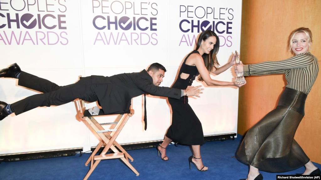 "Wilmer Valderrama, from left, Jordana Brewster and Piper Perabo pose for a "" Mannequin"