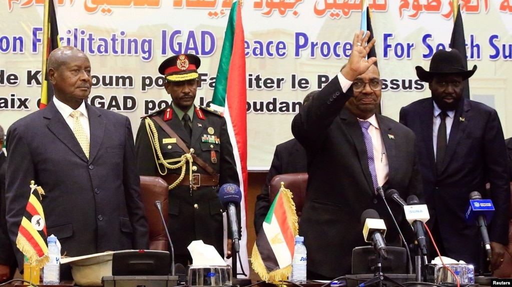 Sudan's President Omar Al-Bashir flanked by Uganda's President Yoweri Museveni and South Sudan's President Salva Kiir welcomes delegates during a South Sudan peace meeting as part of talks to negotiate an end to a civil war, in Khartoum, Sudan, June 25, 2018.