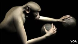 Large-scale brain activity from a rhesus monkey was decoded and used to simultaneously control reaching movements of both arms of a virtual monkey avatar towards spherical objects in virtual reality. Photo: Duke Center for Neuroengineering