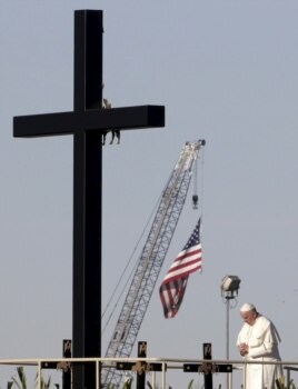 Pope Francis stands next to a wooden cross at the border between Mexico and the U.S. in Ciudad Juarez, Mexico, Feb. 17, 2016.