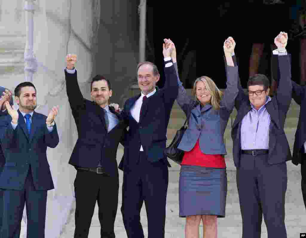 Plaintiffs in Hollingsworth v. Perry, the California Proposition 8 case, react on steps of the Supreme Court in Washington, June 26, 2013, after justices cleared the way for the resumption of same-sex marriage in California.