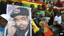 Supporters of Ethiopia People Revolutionary Front (EPRDF) hold a poster bearing Ethiopian Prime Minister Meles Zenawi, 20 May 2010