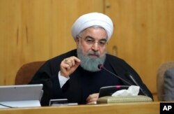 In this photo released by official website of the office of the Iranian Presidency, President Hassan Rouhani speaks in a cabinet meeting in Tehran. Dec. 31, 2017. After a wave of economic protests swept major cities in Iran, President Rouhnai said that pe