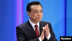 Chinese Premier Li Keqiang claps as he attends the opening ceremony of the Boao Forum for Asia (BFA) Annual Conference 2014 in Boao, Hainan province, April 10, 2014.